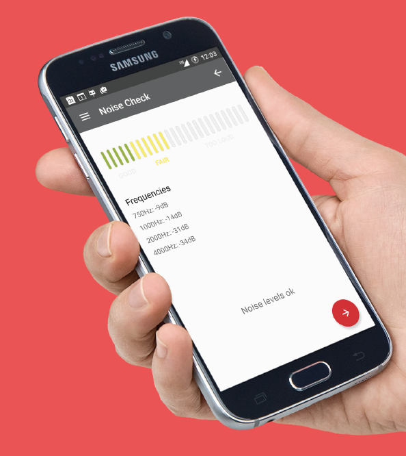 Image show hand holding a smartphone with a screen image from the hear screen application, a frequency indicator.